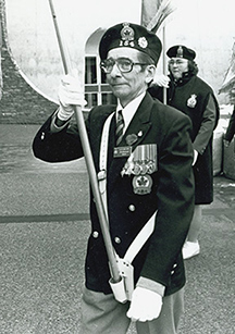 Ron carrying the colors during a Royal Canadian Legion Remembrance Day Procession.